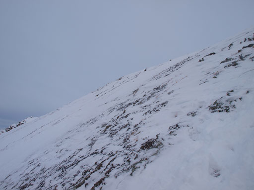 Descending snow covered slabs (not scree) near the summit was pretty difficult