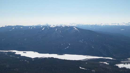 Mount Louie (a treed bump) rises behind Victor Lake and Grande Cache Lake
