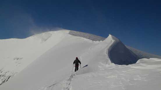 Going back along the summit ridge
