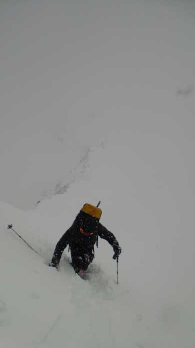 Ascending the steep lower ridge. Knee deep post-holing on snowshoes, certainly not step-kicking as described by other trip reports...