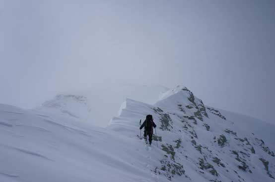 Me ascending the challenging terrain on the connecting ridge. Photo by Ferenc Jacso
