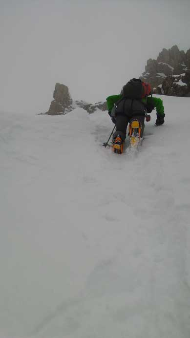 Vern down-climbing the gully. I was bombasted by snow balls.