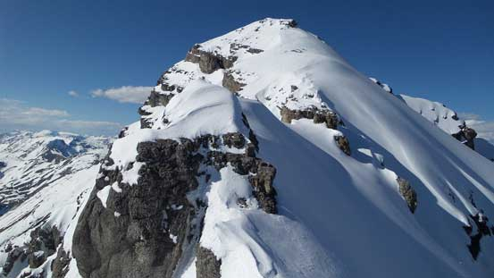 The complex summit ridge. Ahead is the first rock step crux