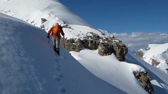 Traversing steep snow to avoid cornices that we couldn't tell the boundary