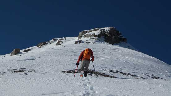 Ben ascending easy terrain towards the summit block