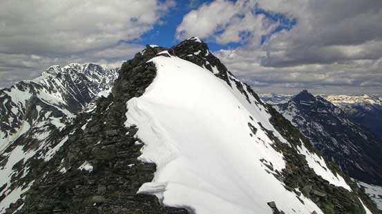 On the summit ridge, ahead is the false summit