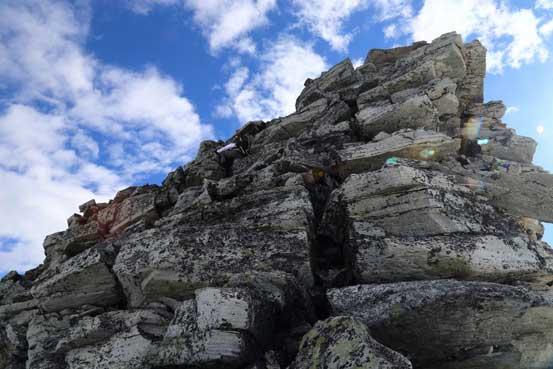 Me scrambling up the summit block. Photo by Ben
