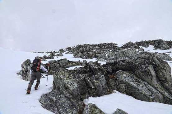 Me nearing the ridge. I'd soon don crampons as the snow was hard to kick in