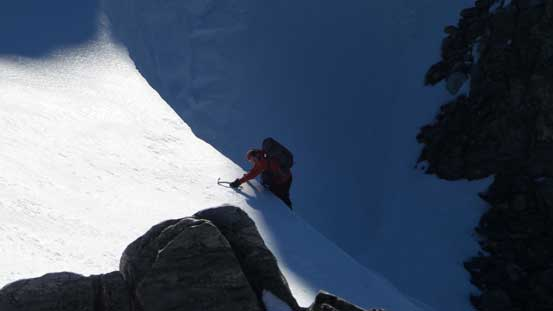Ben climbing over a vertical band/cornice. The ice tool helped a big time here