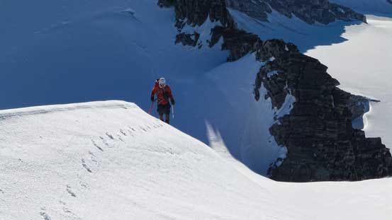 Ben ascending the summit ridge