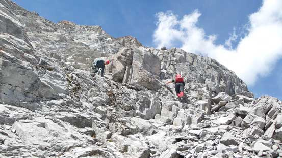 Descending the summit block to access the scree ledge