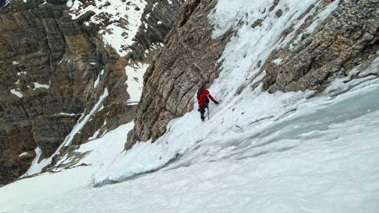 Ben ready to tackle the crux - crossing this ice gully.... This photo looks insane. I don't know how we gathered the courage