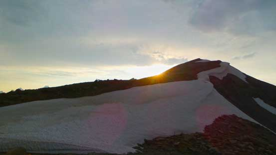 Sun setting behind the ascending ridge to Copperstain