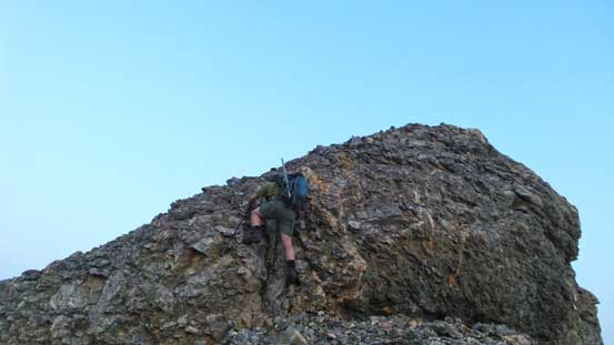 Eric scrambling up an optional rock band on the connecting ridge