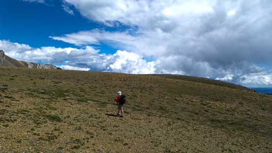 Ben hiking up the grassy plateau. It was windy here