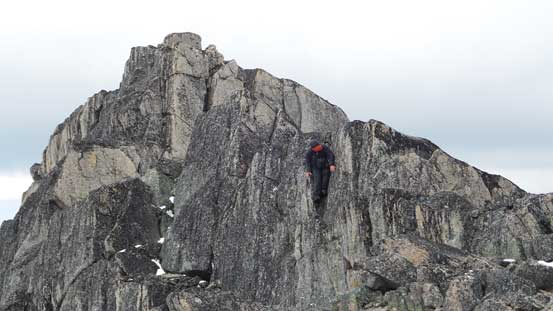 Ben descending a challenging step on the connecting ridge