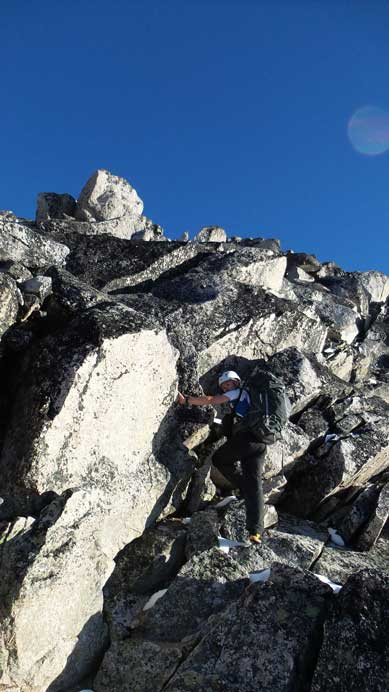Ben scrambling up the typical terrain on the lower ridge
