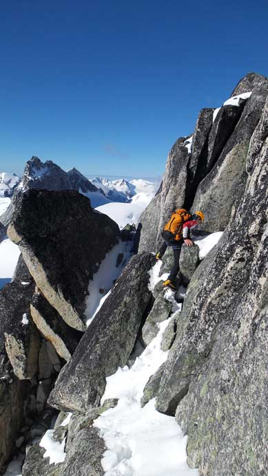 Ferenc had to traverse an exposed, down-sloping and snow coated ledge to the base of 5.4 chimney/crack.
