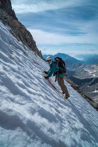 Me traversing the steep snow. Photo by Vern