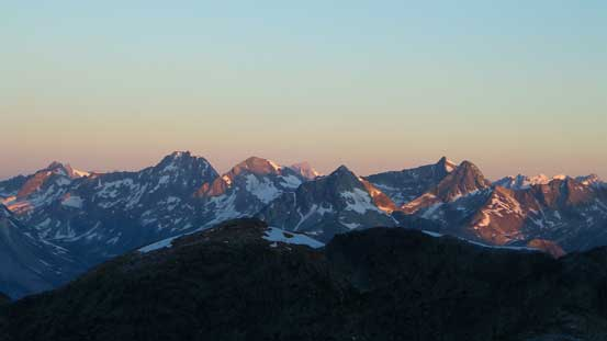 Alpenglow on the peaks north of Highway 1 - Cheops Mountain, etc.