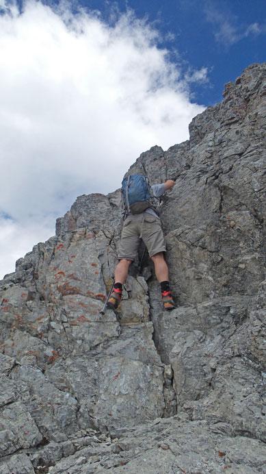 Eric down-climbing a short step near the summit