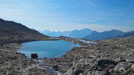 This alpine tarn would be a three star bivy spot. If you objective is only Prince George then I'd suggest going all the way to here.