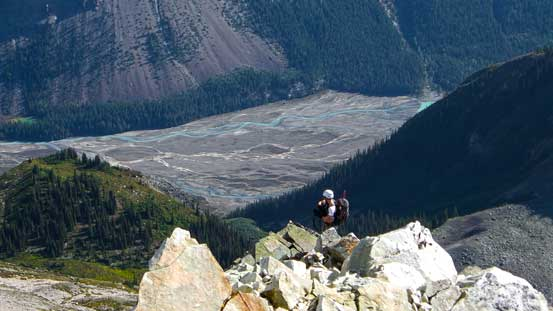 Ben ascending the ridge with the braided Robson River way down below