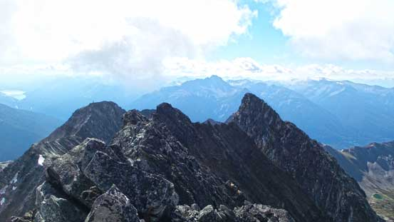 Looking back from the true summit. False summit is the lower bump on left