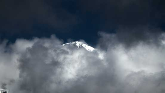 The snowy summit of Robson poking through - makes it looking like a Himalayan giant