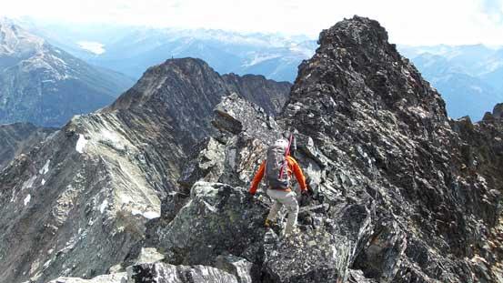 Ben traversing back the summit ridge
