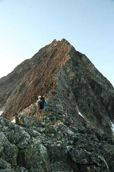 Me at the col with NW Ridge ahead. Looks very exciting. Photo by Ben