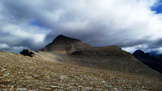 Veering right and slogging up a pile of scree, we started to see Mt. Folk