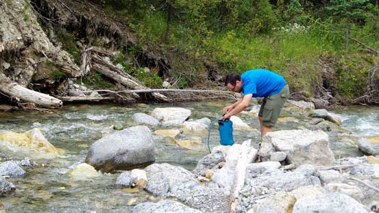 Eric filling up water at the creek. I filled up 3 L here as the entire ascent was dry.