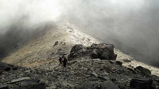 Hiking up the summit pyramid, we entered the clouds
