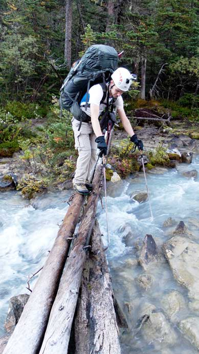 Crossing a slippery log on the approach trail