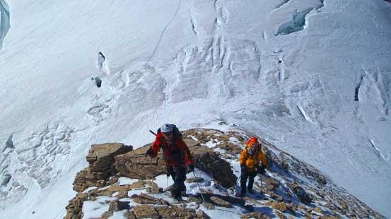 Ben and Vern ascending Diadem Peak. In the background is Woolley's crevasses...