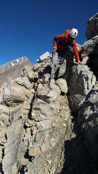 Down-climbing the difficult step to drop into the cirque