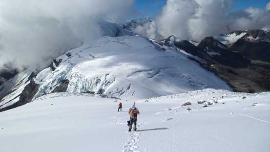 Ascending the small glacier towards the upper mountain. Whiterose Mountain in rear.