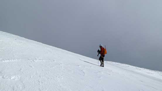 Ben ascending the final snow cap to the summit