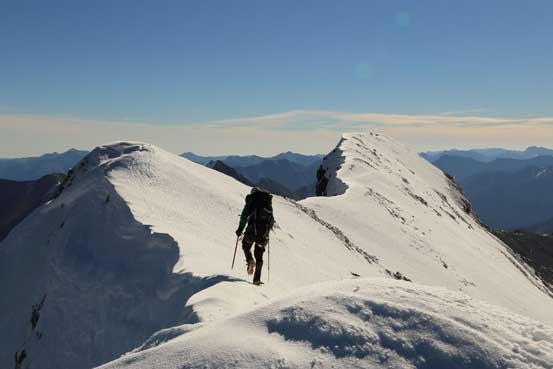 Me traversing the corniced ridge. Photo by Ben