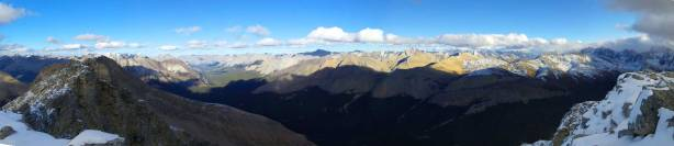 One last panorama from the summit before descending.