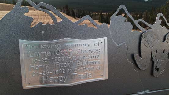 A memorial plaque on a chair.