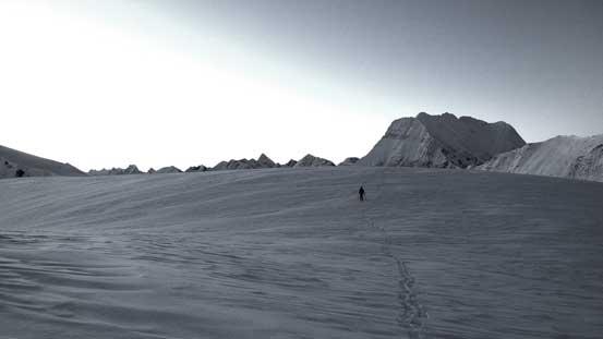 Ben skiing towards a sub-summit