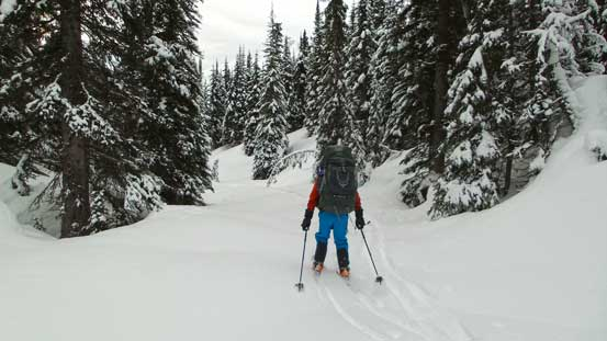 Ben skiing down the tributary of Miette River