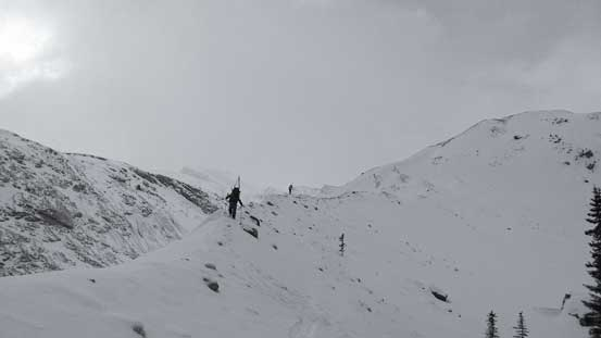 Skis on our packs now. Ascending tediously up the moraine...