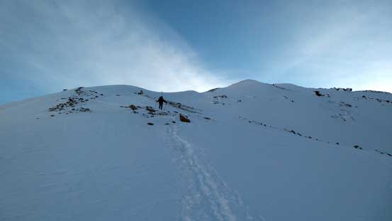 Skis strapped on our packs, descending the moraine