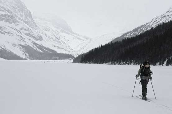 Skinning across Peyto Lake in marginal weather. Photo by Ben