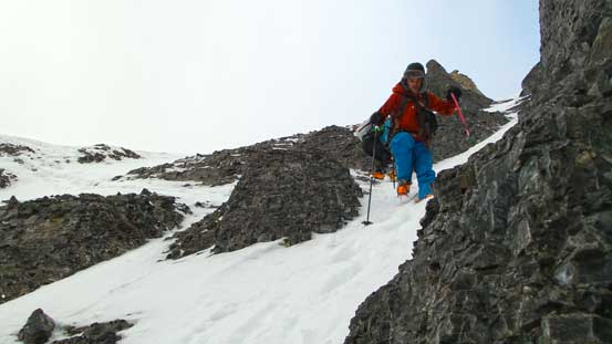 Descending the thin and steep ledges