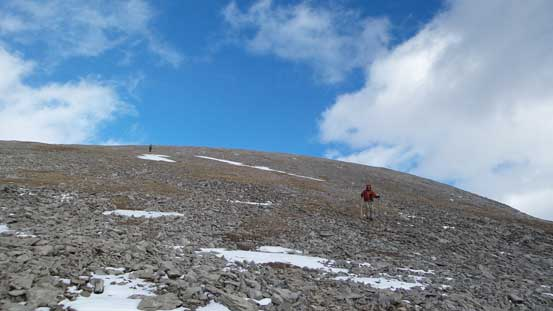 Hiking down the scree slope below the true summit