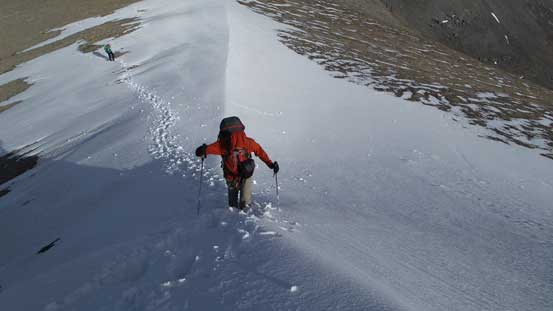 Ben re-ascending the snow arete to the 3rd false summit